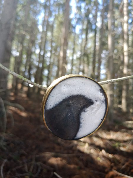 South Island Raven, 2019, brooch; brass, gypsum plaster, pigment, resin, steel pin